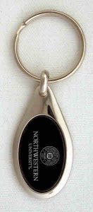 Northwestern Wildcats Laser Engraved Oval Black/Silver Key Chain with Seal Design